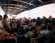 - People Watching on a Long Boat in Indonesia -